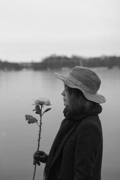Woman with hat and flower Hat Stockholm Sweden Winter Woman Adult Beauty In Nature Close-up Day Flower Focus On Foreground Girl Girl With Hat Holding Lake Leisure Activity Nature One Person Outdoors People Real People Sky Standing Woman Portrait Young Adult