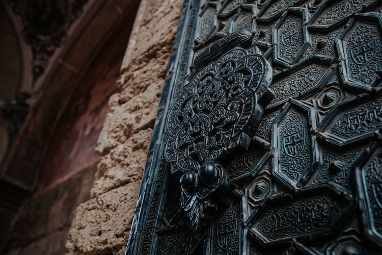 Low angle view of carving on old building