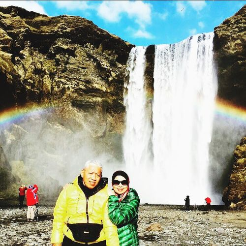 EyeEmNewHere Rainbow🌈 Waterfall #water #landscape #nature #beautiful Yellowjacket Outdoors Vacations Real People Looking At Camera Togetherness Mountain Husbandandwife Iceland Memories EyeEmNewHere EyeEmNewHere