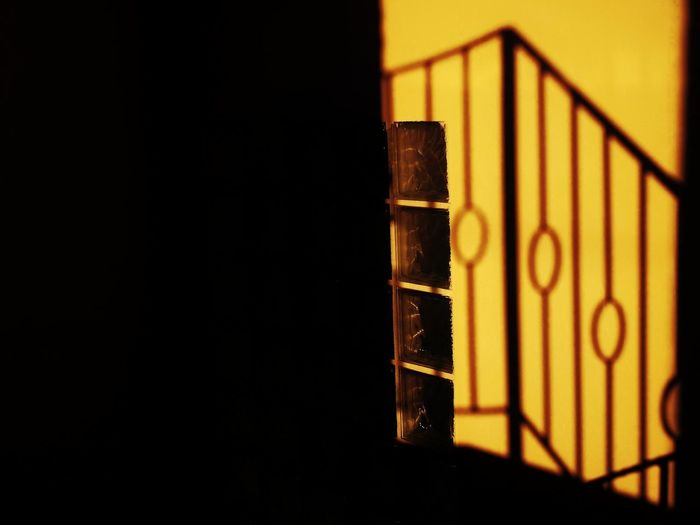 Light And Shadow Light In The Darkness Reflection Shadows & Lights Walking Around Streetphotography Wall - Building Feature EyeEm Selects Nightphotography Smartphonephotography WeekOnEyeEm Dim Light Shadow Close-up Architecture Wrought Iron Steps And Staircases Steps Stories From The City