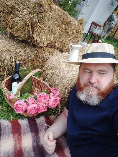 Portrait of man wearing hat against plants
