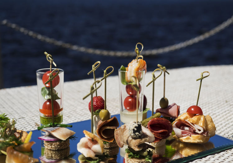 Various canapes and snacks served on platter