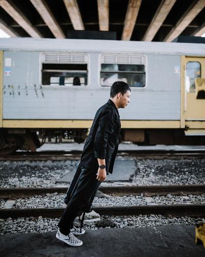 Side view of man in train at railroad station in yogyakarta jembatan janti