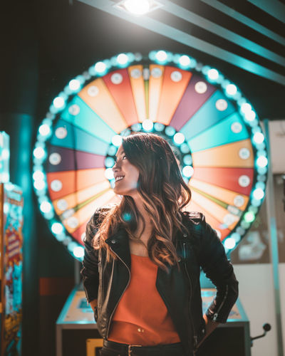 Woman standing in amusement park ride