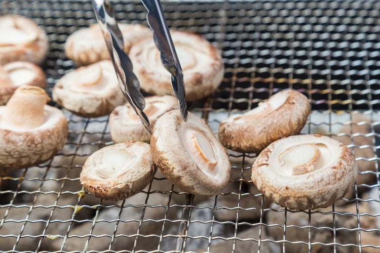 Shitake mushroom being grilled
