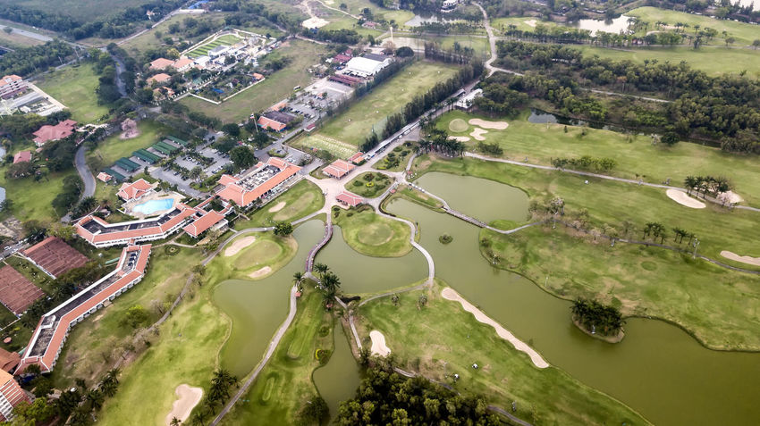 Aerial View Agriculture Architecture Beauty In Nature Building Exterior Built Structure Day Golf Golf Course Green - Golf Course Green Color High Angle View House Landscape Nature No People Outdoors Patchwork Landscape River Scenics Tranquility Tree Water