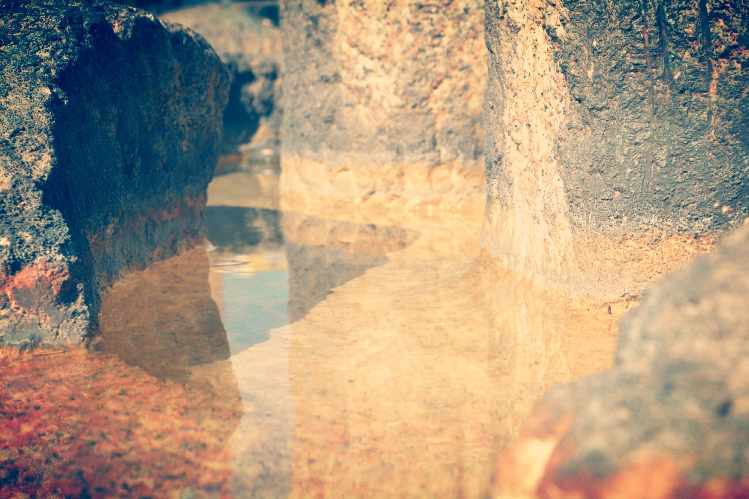rock formation, rock - object, geology, nature, water, tranquility, scenics, beauty in nature, rock, tourism, eroded, cave, travel destinations, cliff, sunlight, tranquil scene, physical geography, travel, outdoors, famous place