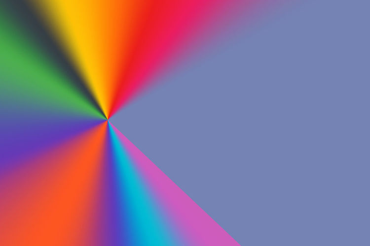 Close-up of rainbow over colored background