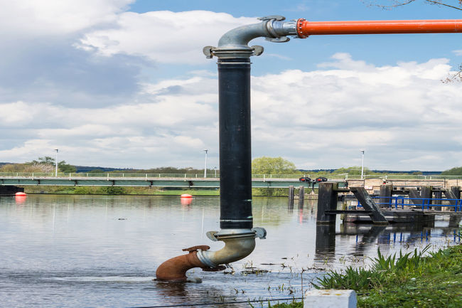 Discharge pipeline to pumping water from a river. Animal Themes Architecture Buildin Site Cloud - Sky Construction Day Energy Gas Pipes Landscape Nature Nautical Vessel No People Outdoors Pipe Bend Pipeline River Seal Sky Skyscraper Sleeve  Tube Water Water Pipe