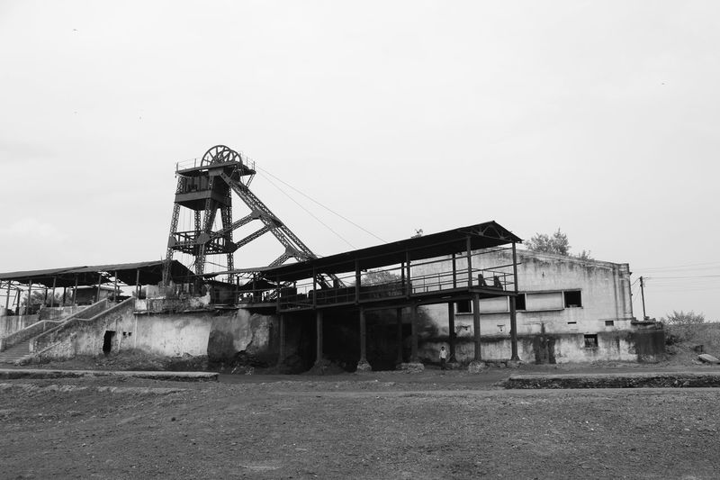 Coal Mine Iron Coal Coal Mining Coalmine Construction Machinery Construction Site Day India Coal Mine Industry Machinery Manufacturing Equipment Monochrome Monochrome Photography No People Outdoors Quarry Sky