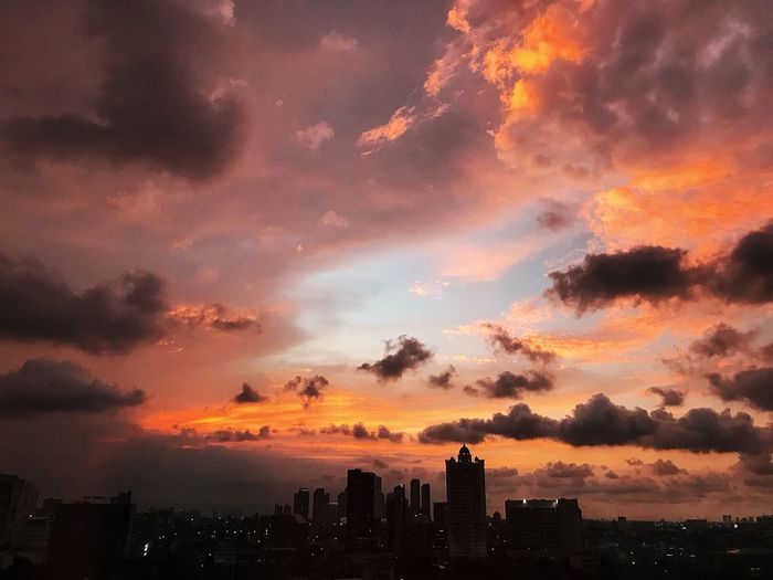Sunset from my office window Architecture Sunset Sky Cloud - Sky City Building Exterior Built Structure Silhouette Nature Landscape Dramatic Sky Cityscape Urban Skyline No People Orange Color Beauty In Nature Building Cloudscape Office Building Exterior Idyllic