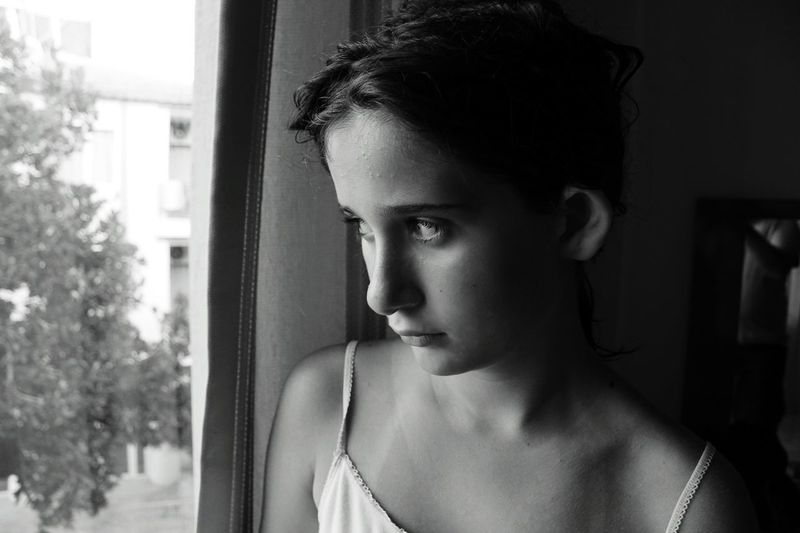 Close-up of young girl looking away