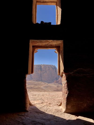 View of historical building through window