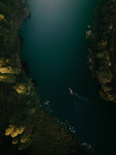 High angle view of boat on river in forest