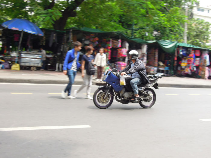 People riding bicycle on city street
