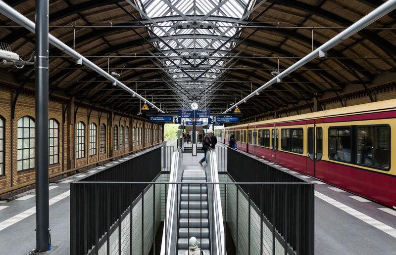 Commuters walking towards train at railroad station
