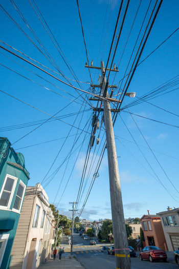 Power to the People Architecture Cable City Complexity Connection Day Electricity  Outdoors Power Line  Sky Street Technology Telephone Line