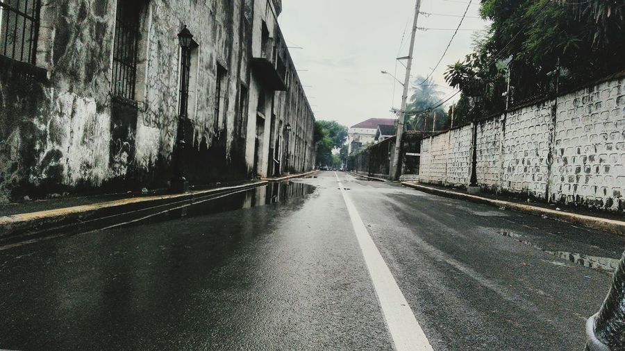 Vantage point. Road Street The Way Forward Wet Outdoors Transportation Architecture City Intramuros,manila Intramuros| Philippines Cheapcamerachallenge Leisure Activity Travel Destinations History Building Exterior Built Structure Personal Perspective Philippines EyeEm Selects