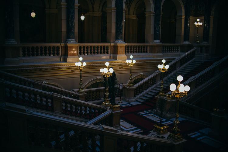 Illuminated lamps against building