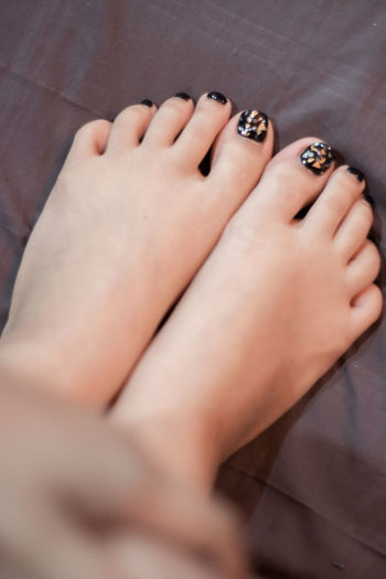 Low section of woman with feet