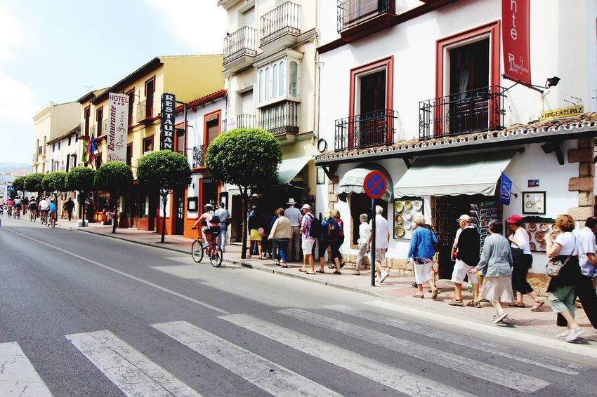 Feel The Journey People Photography Walking In The City Daytime Streetphotography A group of tourists arriving in Ronda walking to the cliffs view! Enjoying Life Tourismus in Ronda Spain Group Of People Buildings & Sky Architecture Facade Bycicle Ride