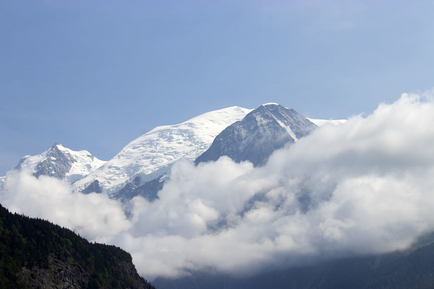 Mont Blanc appears from behind the clouds # Beauty In Nature Cloud - Sky Day Environment Mont Blanc Mountain Mountain Peak Mountain Range Nature No People Scenics - Nature Sky Snow Snowcapped Mountain Switzerland