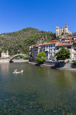 Dolceacqua, Imperia. Liguria (ITALY). The Monet's bridge on the River Nervia. On the hill is located the Doria's castle. Age Ancient Antique Architecture Blue Bridge Castle Dolceacqua Döria Europe European  Exterior Fortification Fortress Historic Historical History Italian Italy Landmark Landscape Liguria Medieval Monet Nerves