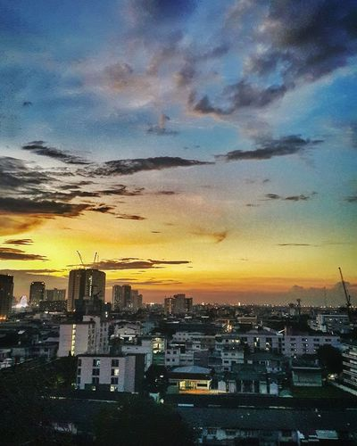 Evening in Bangkok City Cityscape Sunset Skyscraper Urban Skyline Dramatic Sky Sky Architecture Building Exterior Wide Shot Wide Patchwork Landscape Building Story Infrastructure High Rise Tall Tall - High City Location Romantic Sky Calm Office Building