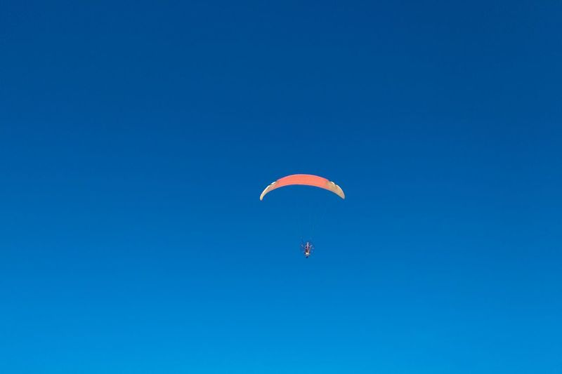 Blue Clear Sky Close-up Day Extreme Sports Flying Full Length Fun Leisure Activity Low Angle View Mid-air Multi Colored Nature One Person Outdoors Parachute Paragliding People Sky