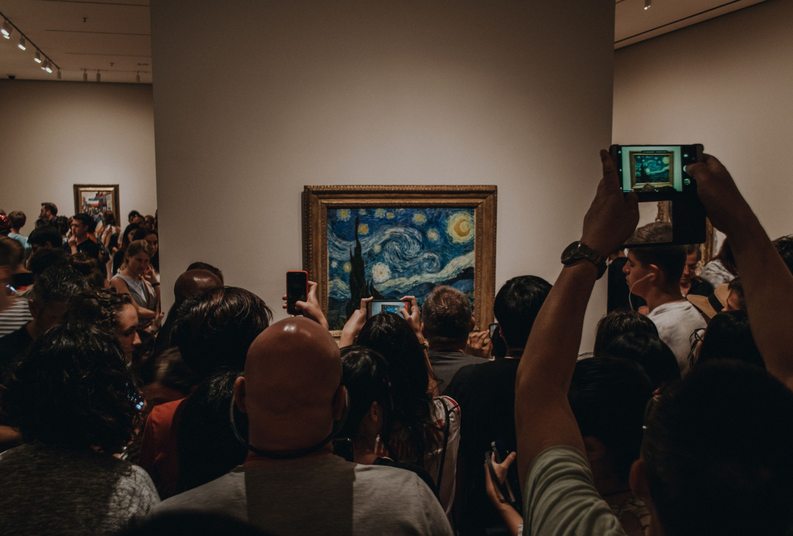 group of people, crowd, large group of people, real people, indoors, lifestyles, women, adult, men, representation, human representation, architecture, museum, picture frame, activity, leisure activity, looking, technology, paintings, watching