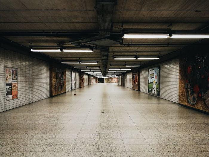 Empty illuminated subway tunnel