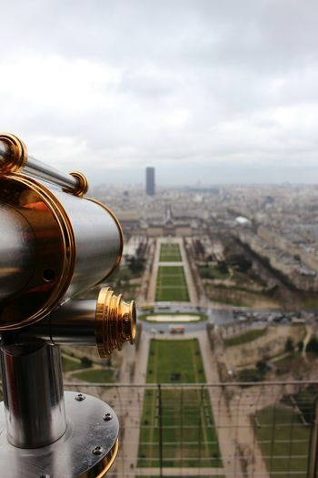 Coin-operated binoculars on eiffel tower overlooking city