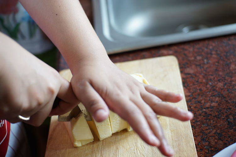 fresh butter Bakery Body Part Butter Child Childhood Close-up Cutting Finger Focus On Foreground Fresh Butter Hand High Angle View Holding Human Body Part Human Hand Indoors  Leisure Activity Lifestyles Making One Person Real People Recipe Selective Focus Unrecognizable Person Wood - Material The Still Life Photographer - 2018 EyeEm Awards
