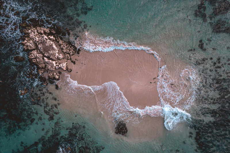 High angle view of waves splashing on shore