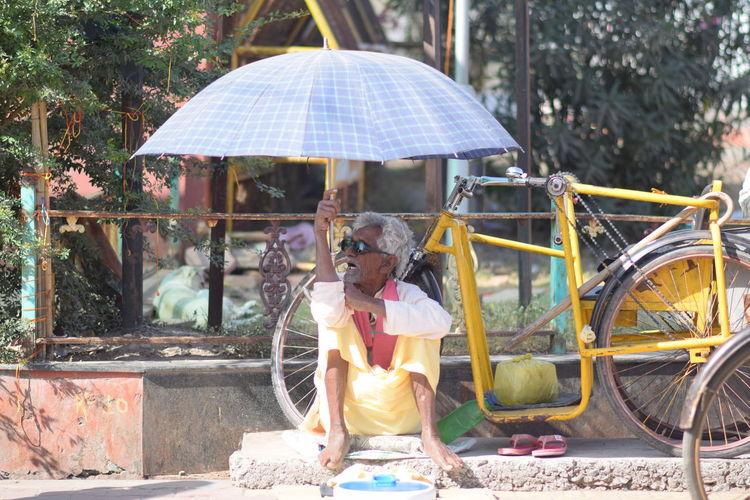 Woman sitting with umbrella