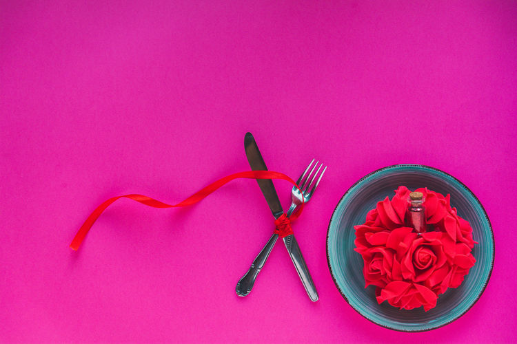 High angle view of pink rose on table