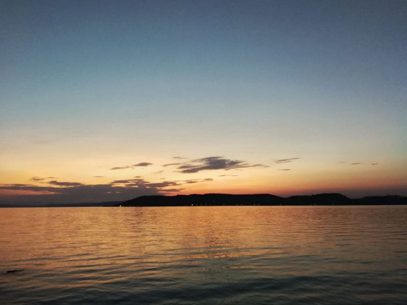 Sunset Water Sky Outdoors Horizon Over Water Nature Cloud - Sky Beach Sun Beauty In Nature No People Travel Destinations Dramatic Sky Landscape Lakebalaton Balaton - Hungary Balaton Hungary Summer Sunset_collection Lake Lake View