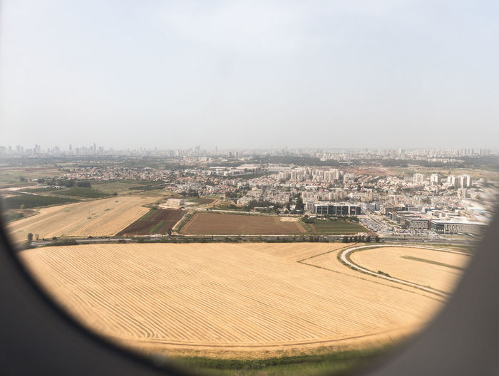 Tel Aviv, Israel, May 01, 2019 : View of the suburbs of Tel Aviv from the window of a flying airplane, near Tel Aviv in Israel Day Outdoors Mediterranean Sea Coast Tel Aviv Israel Suburb Travel Destinations Vacation Flight Tourism Airplane Trip Transport Water Panorama Departure Cityscape Embankment Sky Airport Comfort Building International Technology