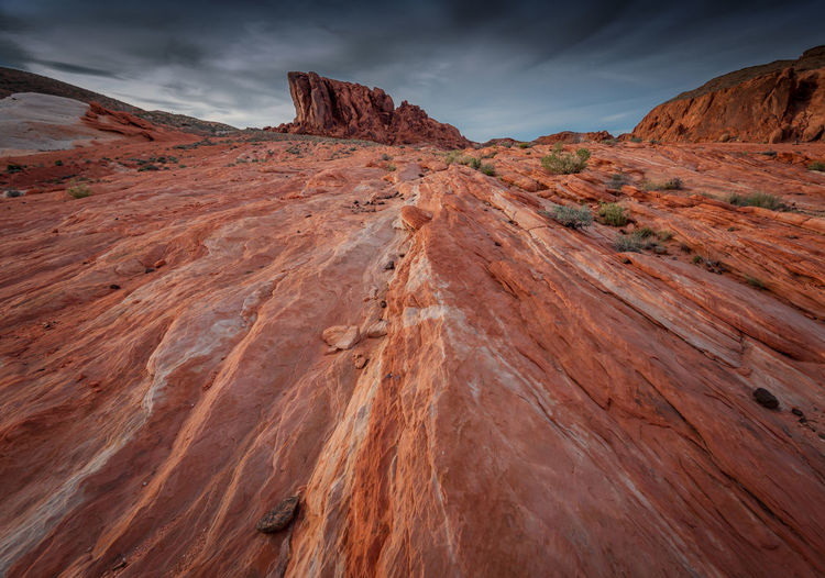 Valley of Fire, Nevada Arid Climate Barren Beauty In Nature Brown Cloud Cloud - Sky Day Desert Eroded Extreme Terrain Geology Landscape Mountain Nature Non-urban Scene Outdoors Physical Geography Remote Rock Rock - Object Rock Formation Scenics Sky Tranquil Scene Tranquility