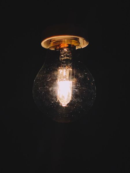 Electricity  Light Bulb Lighting Equipment Illuminated Black Background Studio Shot Filament Bulb No People Close-up Single Object Fuel And Power Generation Low Angle View Technology Indoors  Dark