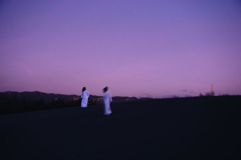 Two People Sky Real People Togetherness Women Men Standing Nature Couple - Relationship Adult Lifestyles Full Length Copy Space Leisure Activity Landscape Land People Outdoors Purple Bonding