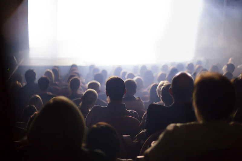 people watching play at the theater Group Of People Crowd Arts Culture And Entertainment Large Group Of People Performance Audience Enjoyment Event Real People Music Nightlife Men Women Stage Popular Music Concert Light Fun Music Festival Watching Stage Light Excitement Rows Spectators Back Amusement