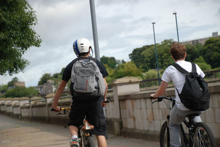 1 Helmet 2 Boys On Bikes Perthshire Bicycle Cloud - Sky Cycling Cycling Helmet Day Headwear Helmet Leisure Activity Lifestyles Men Mode Of Transport Outdoors Real People Rear View Sky Togetherness Transportation Two People Young Adult