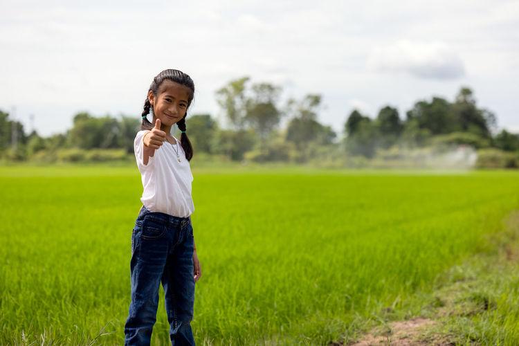 Full length of man using mobile phone on field