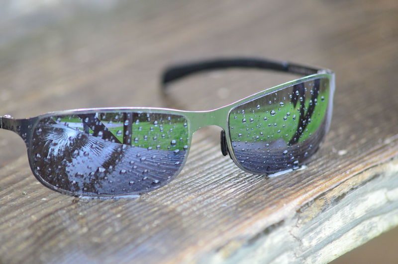 Close-up of sunglasses on glass table