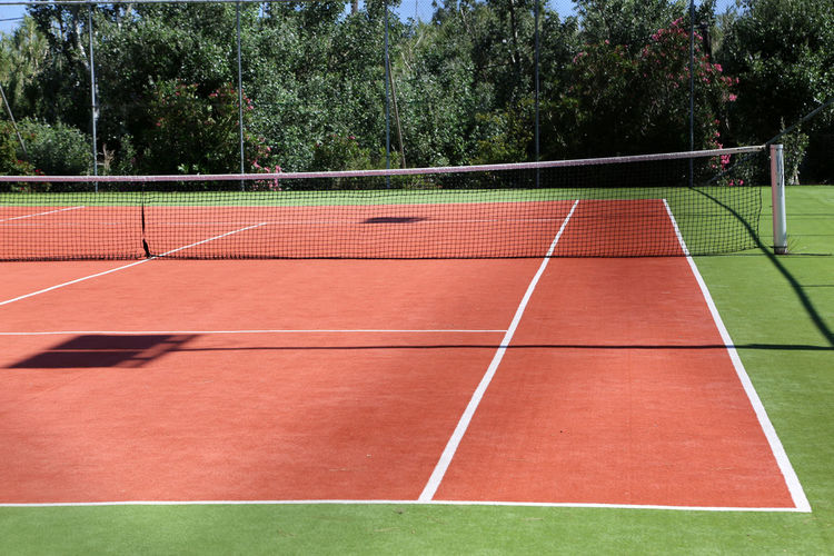 Absence Beauty In Nature Competition Competitive Sport Court Day Grass Nature Net - Sports Equipment No People Outdoors Playing Field Running Track Sky Sport Sports Track Sports Venue Tennis Tennis Net Track And Field Tree