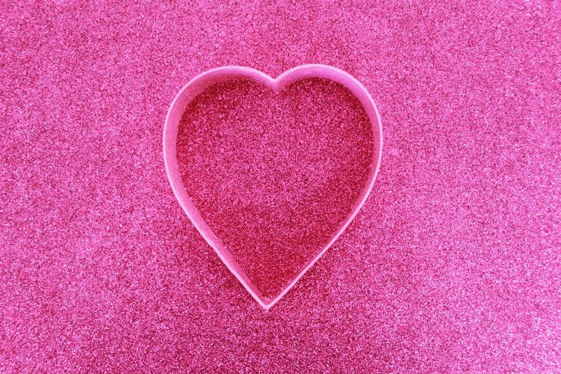Close-up of heart shape on pink fabric