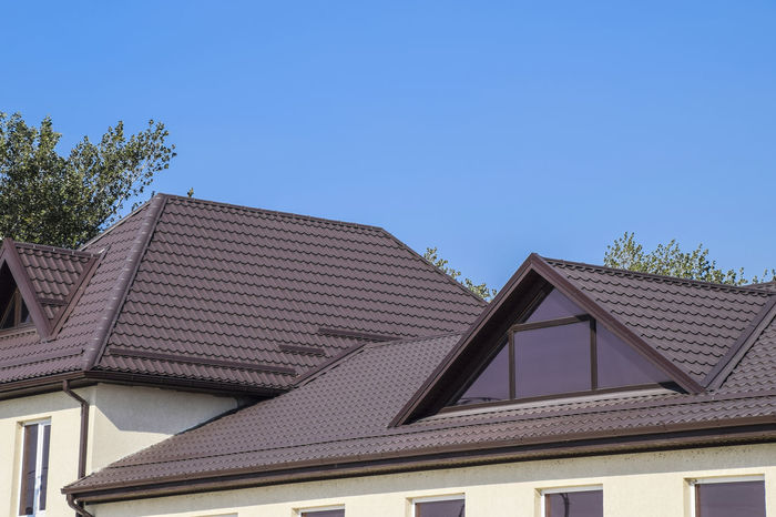 metal profile corrugated roof Architecture Blue Building Exterior Built Structure Clear Sky Day House Low Angle View Metal Profile Corrugated Roof No People Outdoors Roof Sky Tiled Roof  Tree Triangle Shape