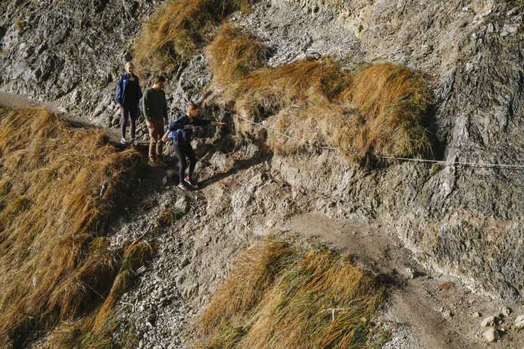 High angle view of people on rock formation