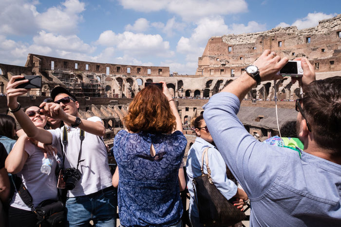 An Eye For Travel Ancient Ancient Civilization Architecture Building Exterior Built Structure Colosseo Colosseum Crowd Day History Lifestyles Old Ruin Outdoors Photographing The Photographer Real People Rome Selfie Selfie Moment Sky Tourism Travel Destinations The Street Photographer - 2017 EyeEm Awards Summer Exploratorium The Traveler - 2018 EyeEm Awards